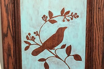 paint washed, stained and stenciled cabinet door